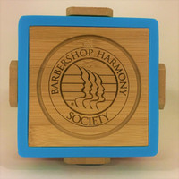 This beautiful set of coasters will not only keep your table dry, but also be a wonderful place setting to any decor. They are made of bamboo and surrounded by a silicone cover.   Coaster set contains one of each color in Blue, Green, Orange, and Red.  Includes a bamboo coaster holder for storage and safe keeping.