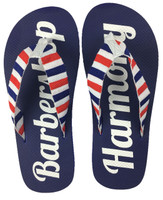"""Let your feet breathe with these Barberpole Flip Flops!  """"Barbershop Harmony"""" is printed on the the cushy blue soles, and the canvas uppers are sure to keep these flops on your feet.   Available in three sizes."""