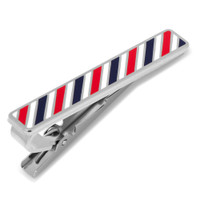 A silver Tie Clip embossed with a red, white, and blue Barberpole motif.   Perfect for any tie, flashy or simple.   This Tie Clip comes with a box for storage.