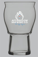 """Stackable and durable, stylish and sensory enhancing, the Afterglow Brewing Co. Glass enhances the colors, flavors, aromas and carbonation of beer, cider, coffee, cocktails and more.  This versatile, ergonomic glass sits comfortably in the hand and on the lip.   Its wide bowl and flared top release aromas and accommodate a proper head, while a heavy base ensures a stable, well balanced glass that's functional for everyday use.    Dimensions: 3 5/8""""w X 5 5/8"""" H"""