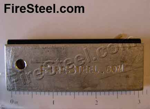 A slab of pure magnesium to which a FireSteel.com FireSteel is attached.  Fire and tinder in one package.