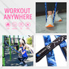 Workout infographic stating you can workout anywhere with the long fitness band including: at home, outdoors, the gym, or while you travel - Female is holding her child at the park while working out with the blue (light/medium) long fitness band attached to the jungle gym