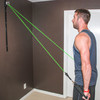 Male performing upper body exercises using elastic tubing resistance bands with the Space Saver Gym