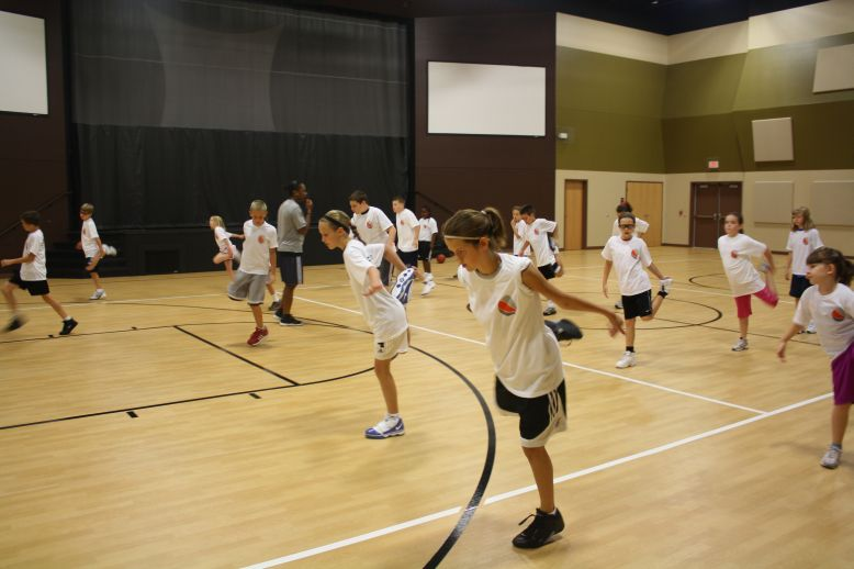 Danielle McCray teaching young athletes at a basketball training camp