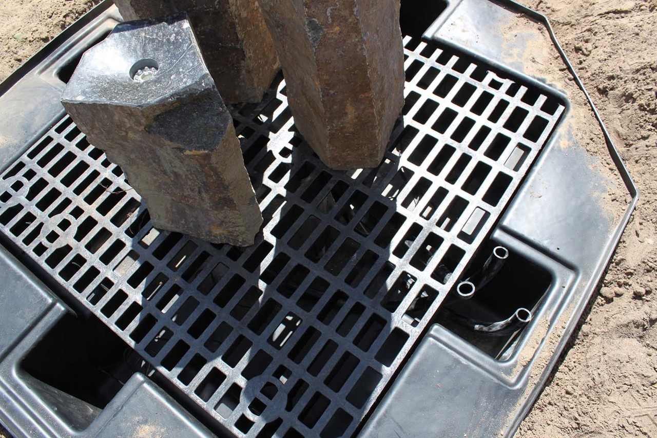 3. Place basalts, using shims to level.