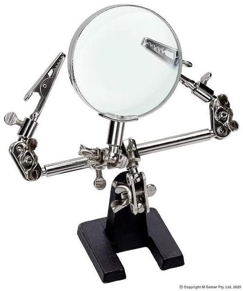 """SPECIFICATIONS Main Beam: 115 mm Arm Reach: 75 mm Lens Dia.: 60 mm  FEATURES The """"helping hand"""" or """"third hand"""" magnifying glass is ideal for small tasks such as wire soldering, electrical circuitry or any miniature job requiring precision assembly. It features a sturdy cast iron base, two articulated alligator clamps and magnifying glass."""