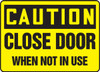 Caution - Close Door When Not In Use Sign