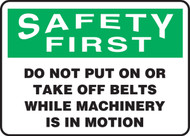 Safety First - Do Not Put On Or Take Off Belts Sign