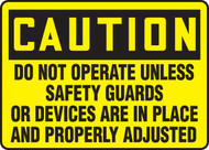 Caution - Do Not Operate Unless Safety Guards Or Devices Are In Place And Properly
