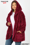 Slightly turned image of Cabernet Faux Fur Hooded Cocoon Plus Size Jacket with Pockets showing hood up