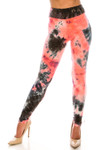 Front side image of Buttery Soft Coral Tie Dye High Waisted Leggings with a black and bright peachy contrasting look.