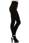Side image of fashion model with one leg forward showing a Black Banded High Waisted Fleece Lined Legging with a ribbed high waisted fabric waist band and warm, tight fit and comfortable full length fit of the fleece fabric