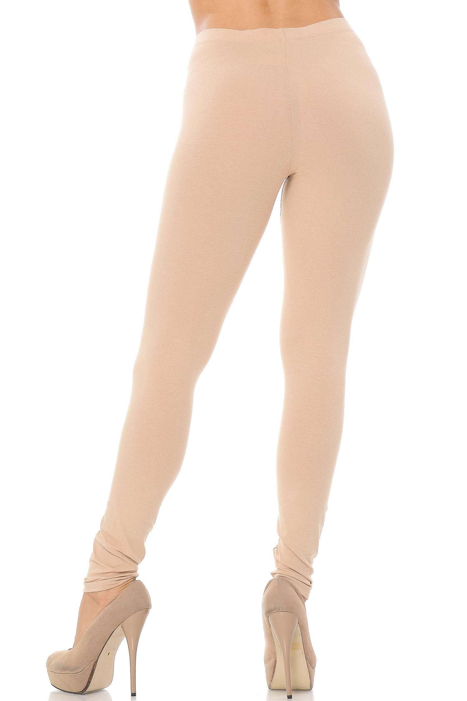 Rear view image of beige made in the USA cotton leggings showcasing a body hugging fit.