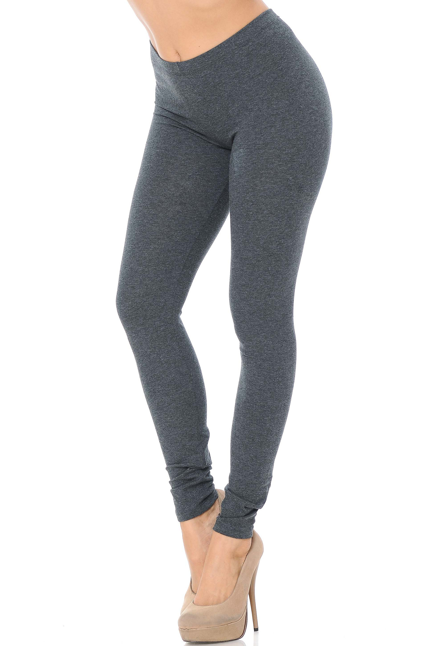 45 degree angle image of female model wearing a charcoal pair of made in the USA cotton leggings showing  a just below the belly button rise and full length going to the ankles.