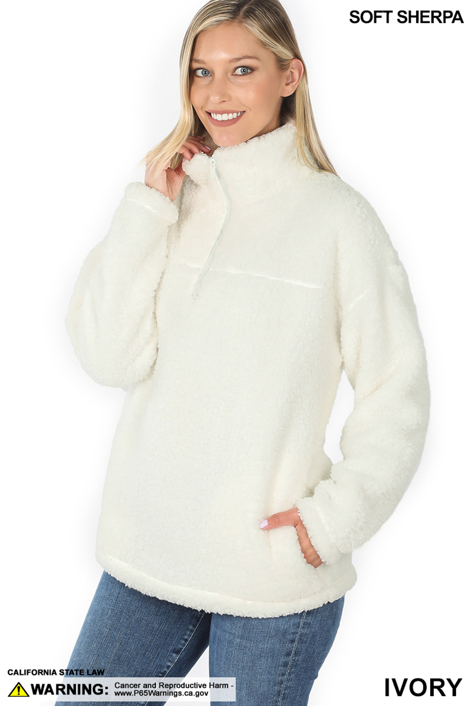 Slightly turned image of Ivory Sherpa Half Zip Pullover with Side Pockets