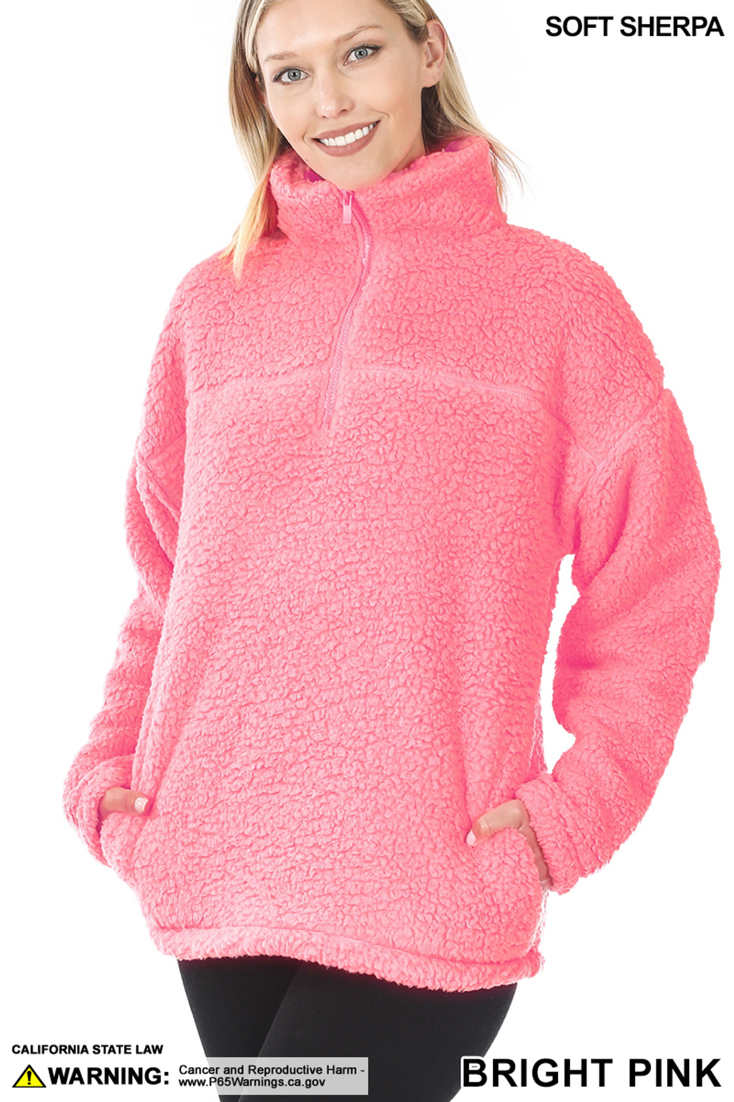Slightly turned image of Bright Pink Sherpa Half Zip Pullover with Side Pockets