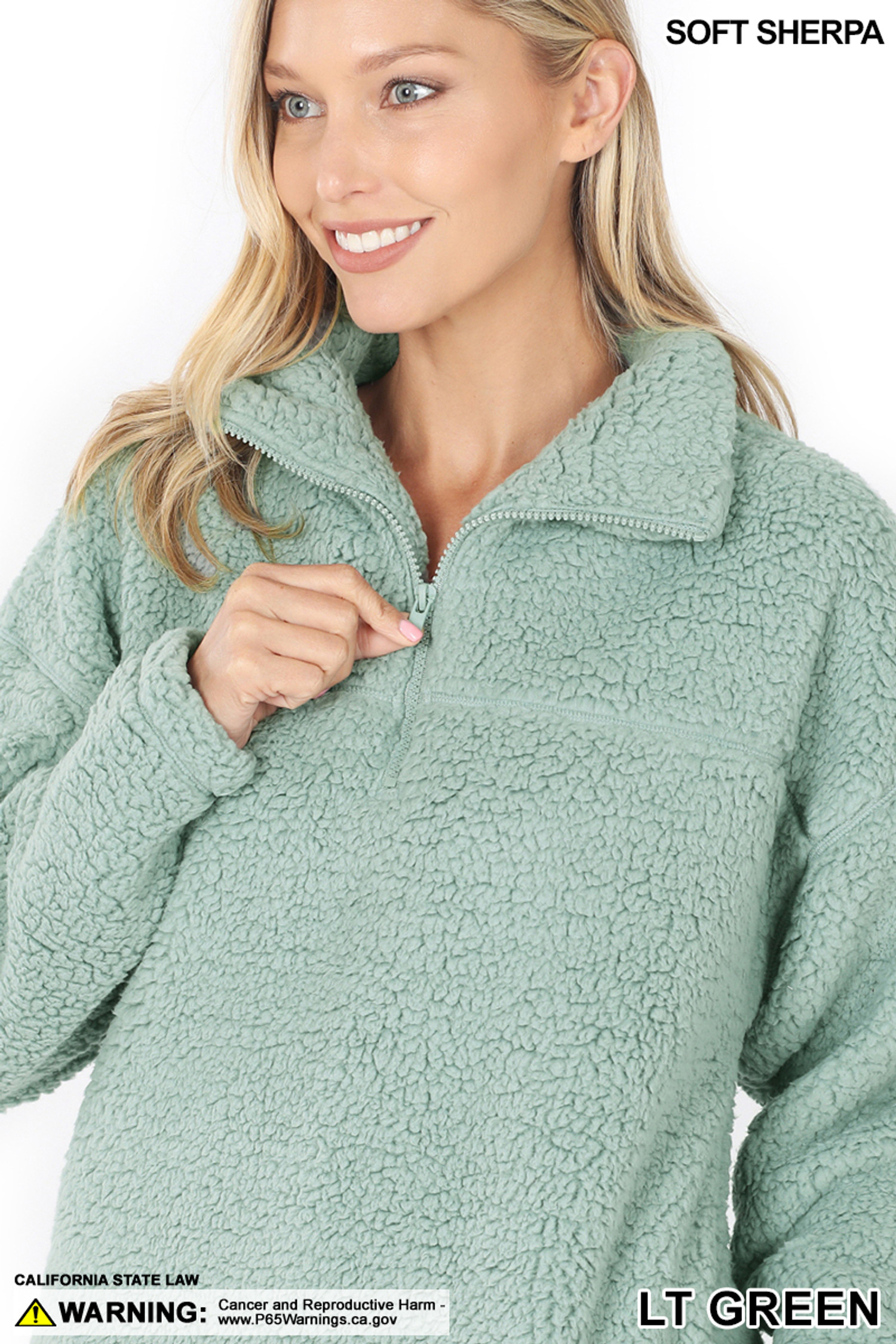 Close up image of Light Green Sherpa Half Zip Pullover with Side Pockets