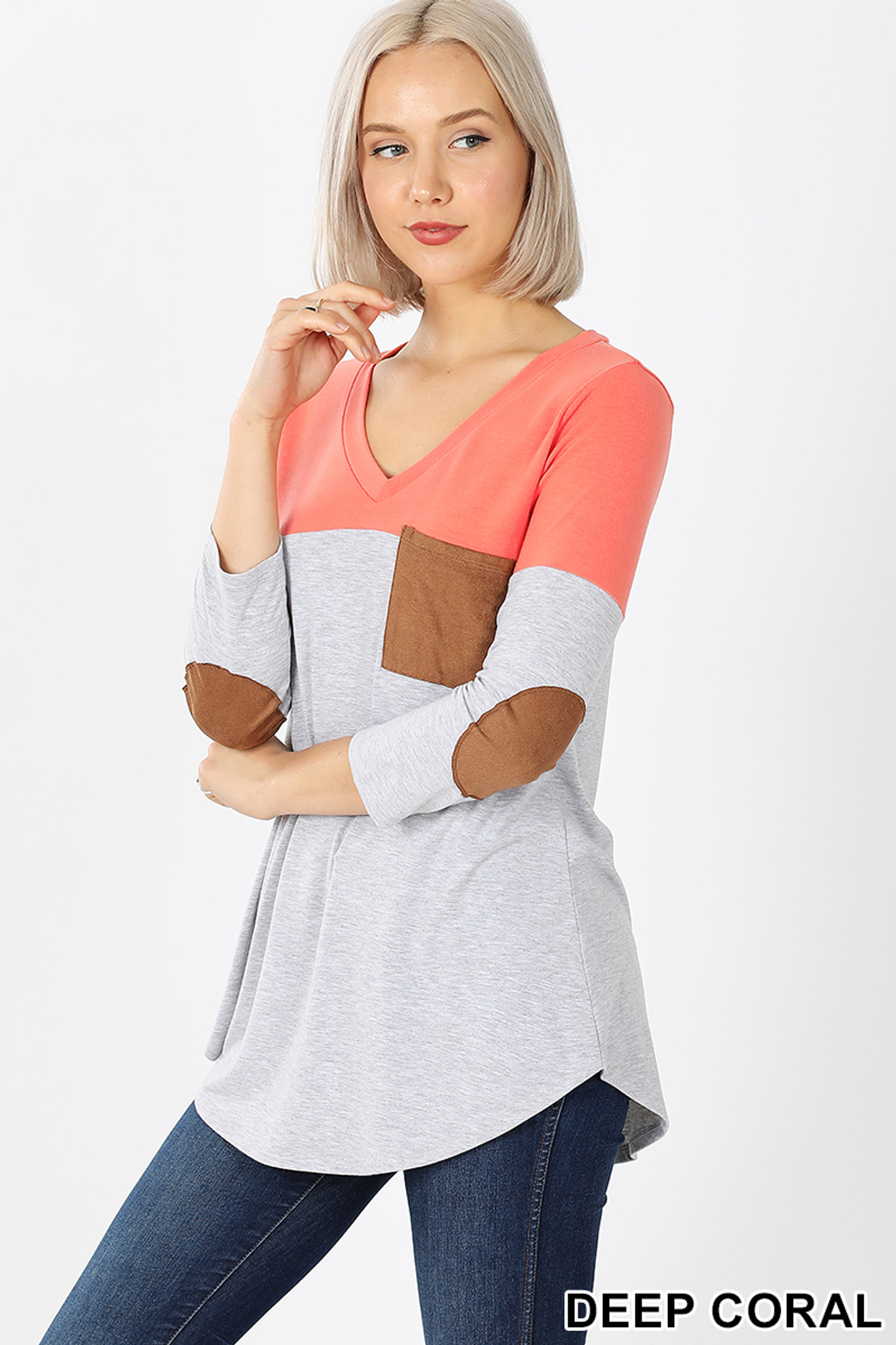 45 degree left view of Deep Coral Color Block V-Neck 3/4 Sleeve Top with Front Pocket