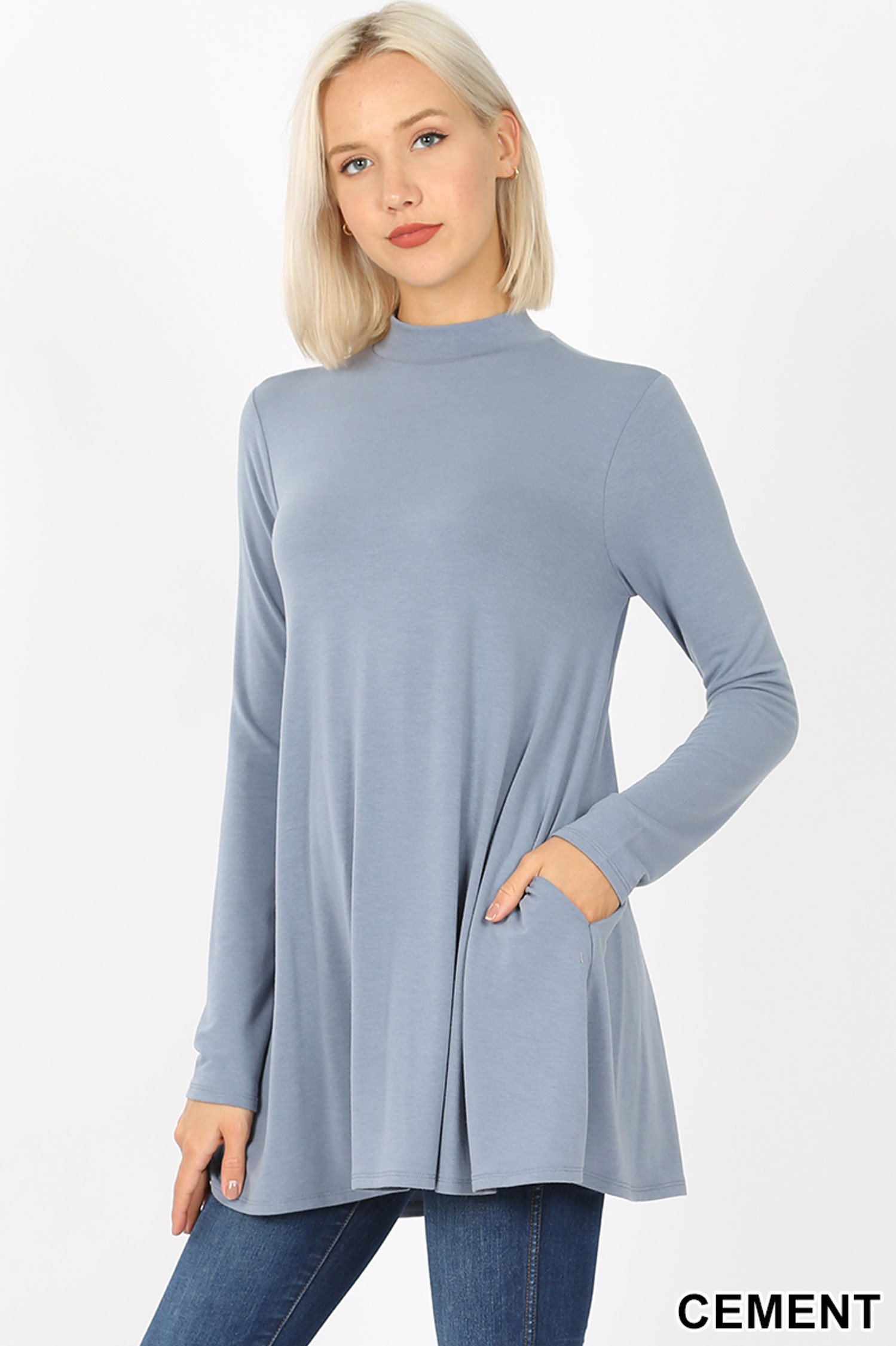 45 degree left side image of Cement Long Sleeve Mock Neck Top with Pockets