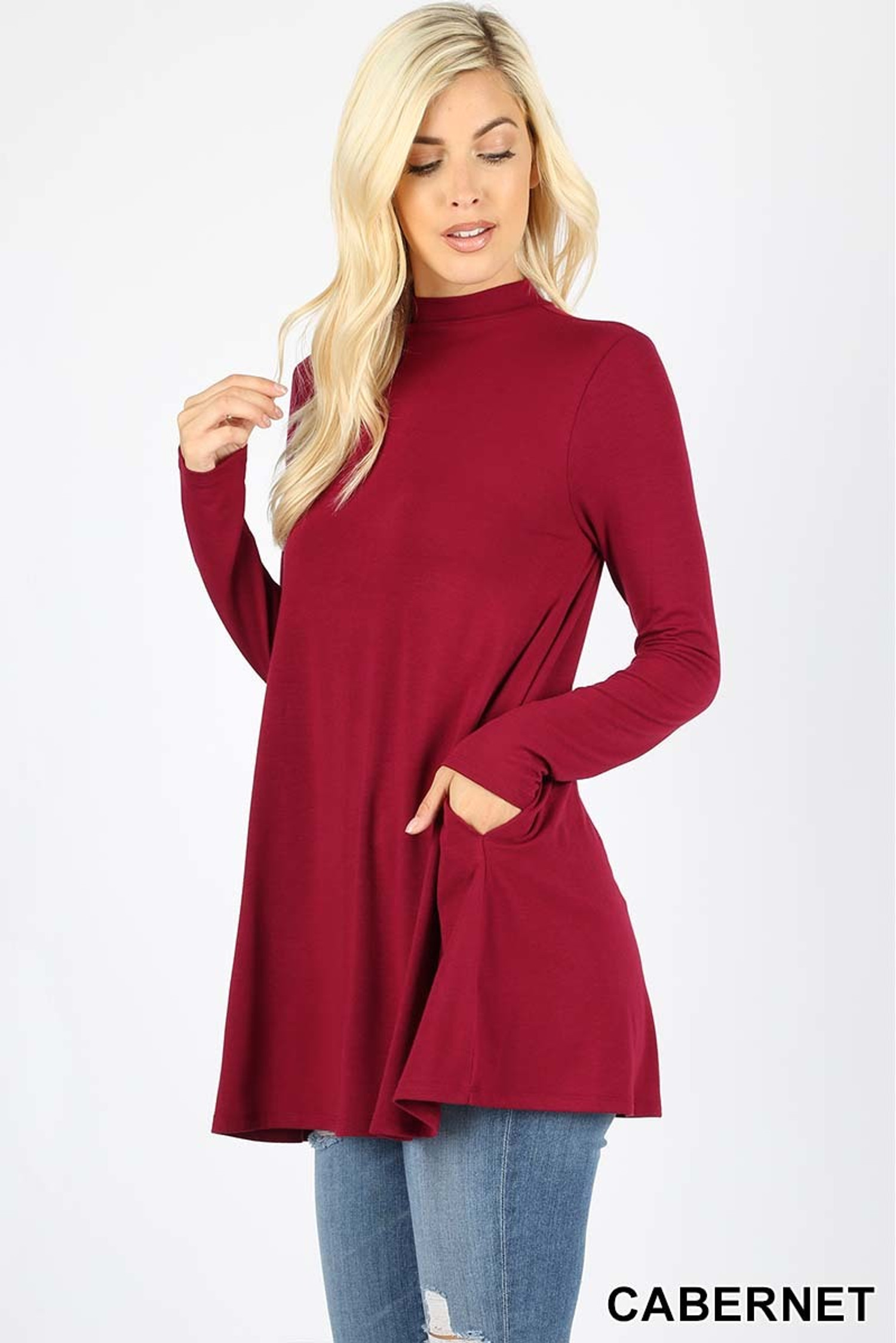 45 degree left side  view of Cabernet Long Sleeve Mock Neck Top with Pockets