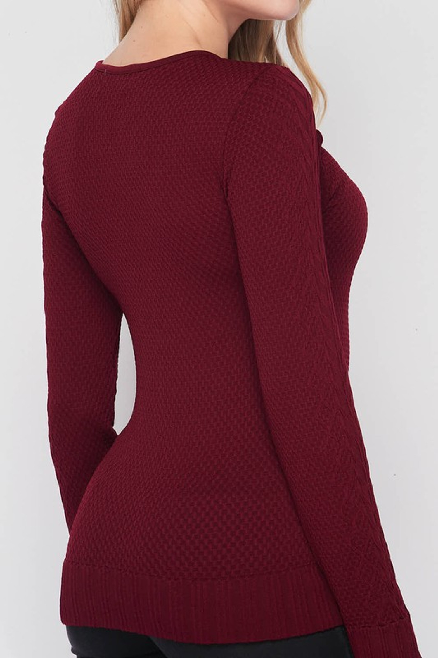 Close-up right side image of Seamless Fitted Mock Neck Cable Knit Top