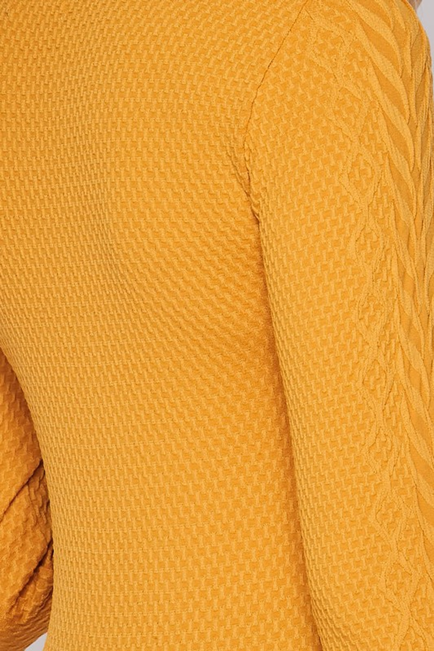 Close-up swatch of Mustard Seamless Fitted Mock Neck Cable Knit Top
