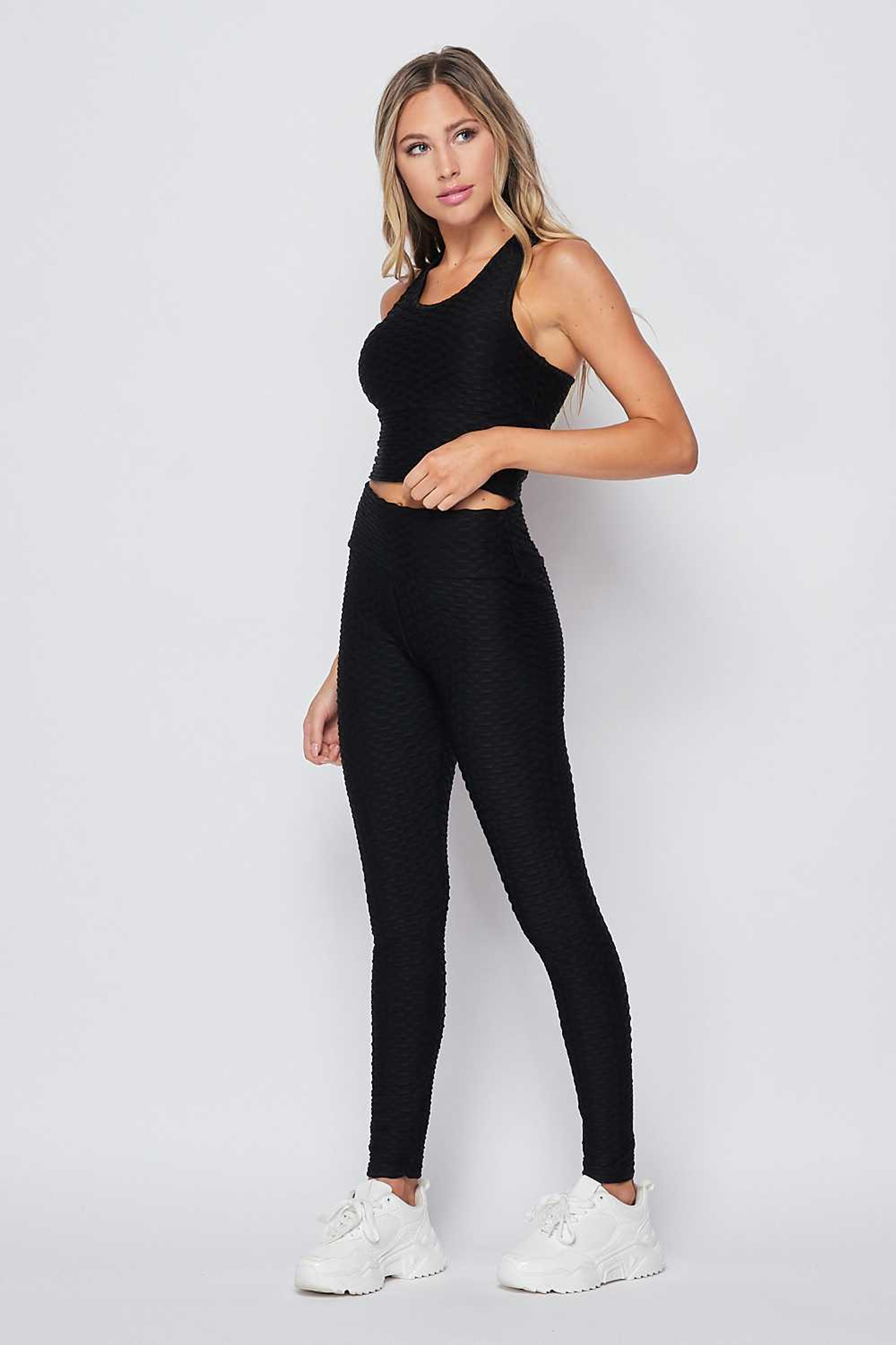 Right side of Black 2 Piece Scrunch Butt Leggings and Crop Top Set