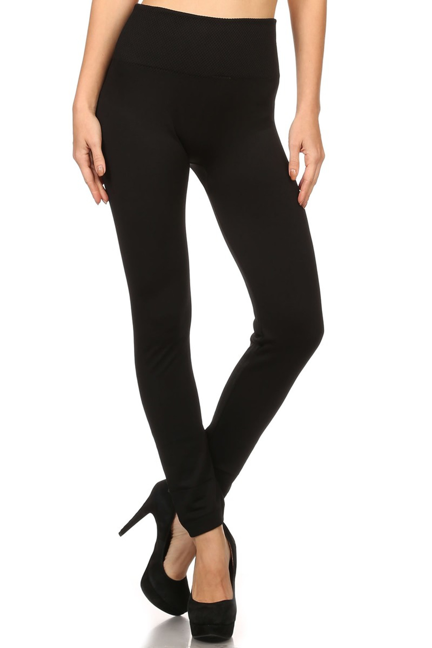 front image of fashion model with legs crossed showing Black Banded High Waisted Fleece Lined Leggings with a ribbed high waisted fabric waist band and warm, tight fit and comfortable full length fit of the fleece fabric