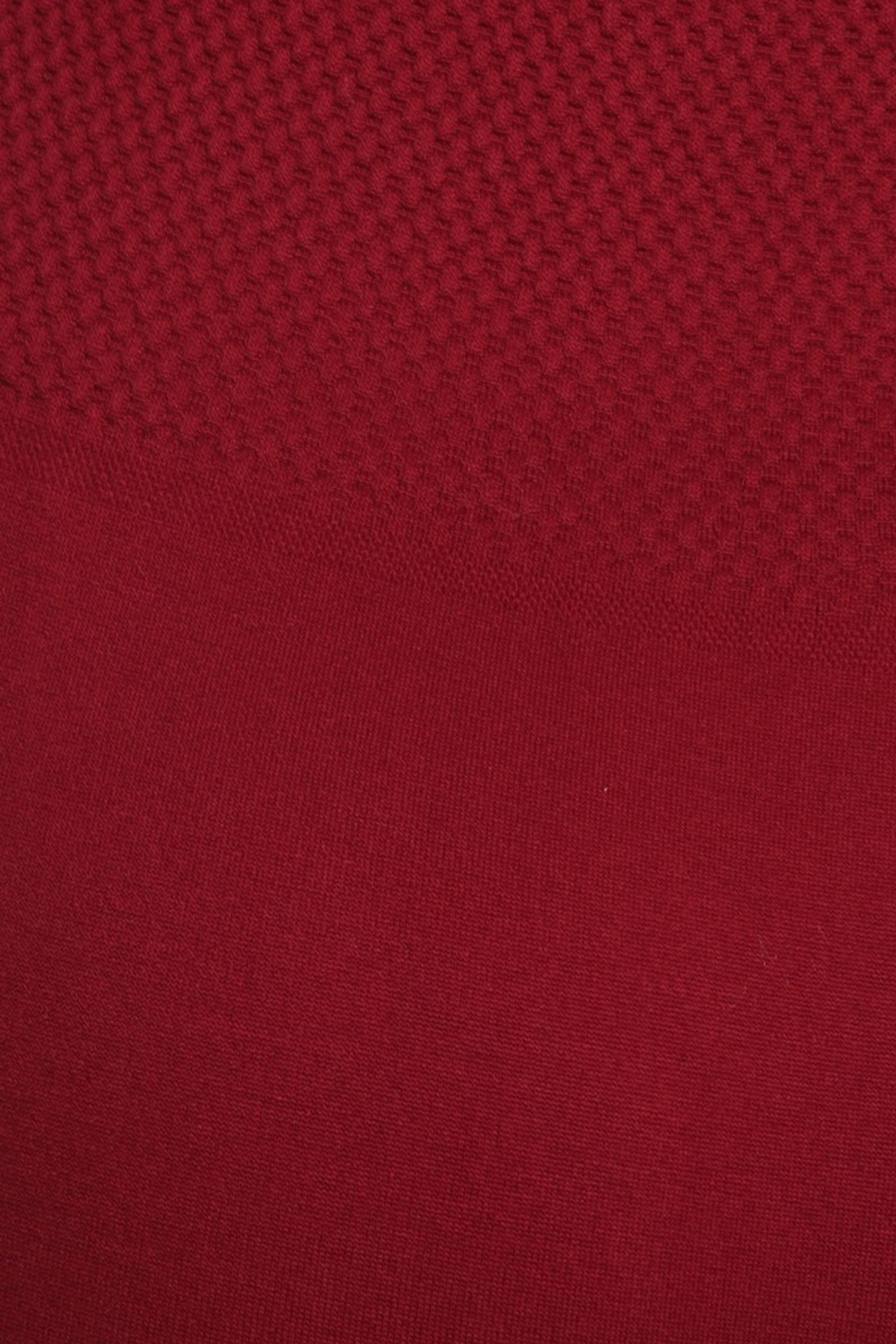 close-up image of a Burgundy Banded High Waisted Fleece Lined Legging of the banded waist band showing the high waist fabric finish and outer fleece fabric