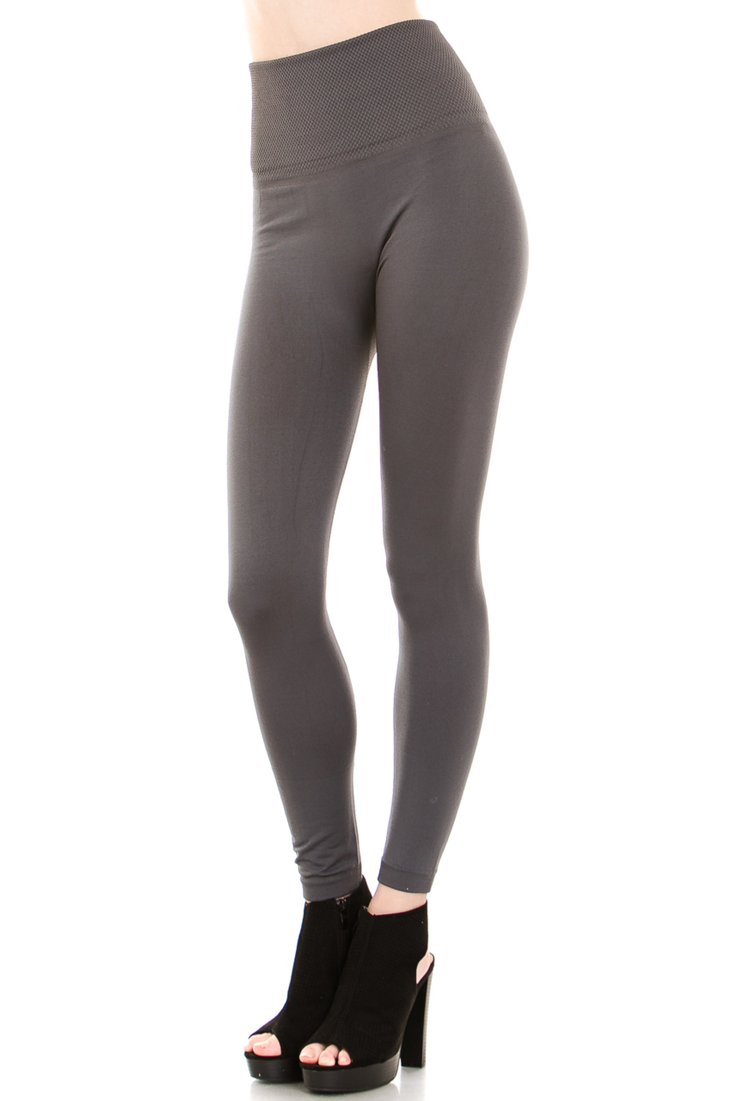 45 degree image of our Charcoal Banded High Waisted Fleece Lined Leggings showing the ribbed high waisted fabric waist band and full length Charcoal fleece legging