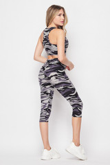 45 degree back right side view of 2 Piece Charcoal Camouflage Crop Top and Capris Set with an all over olive army print design.