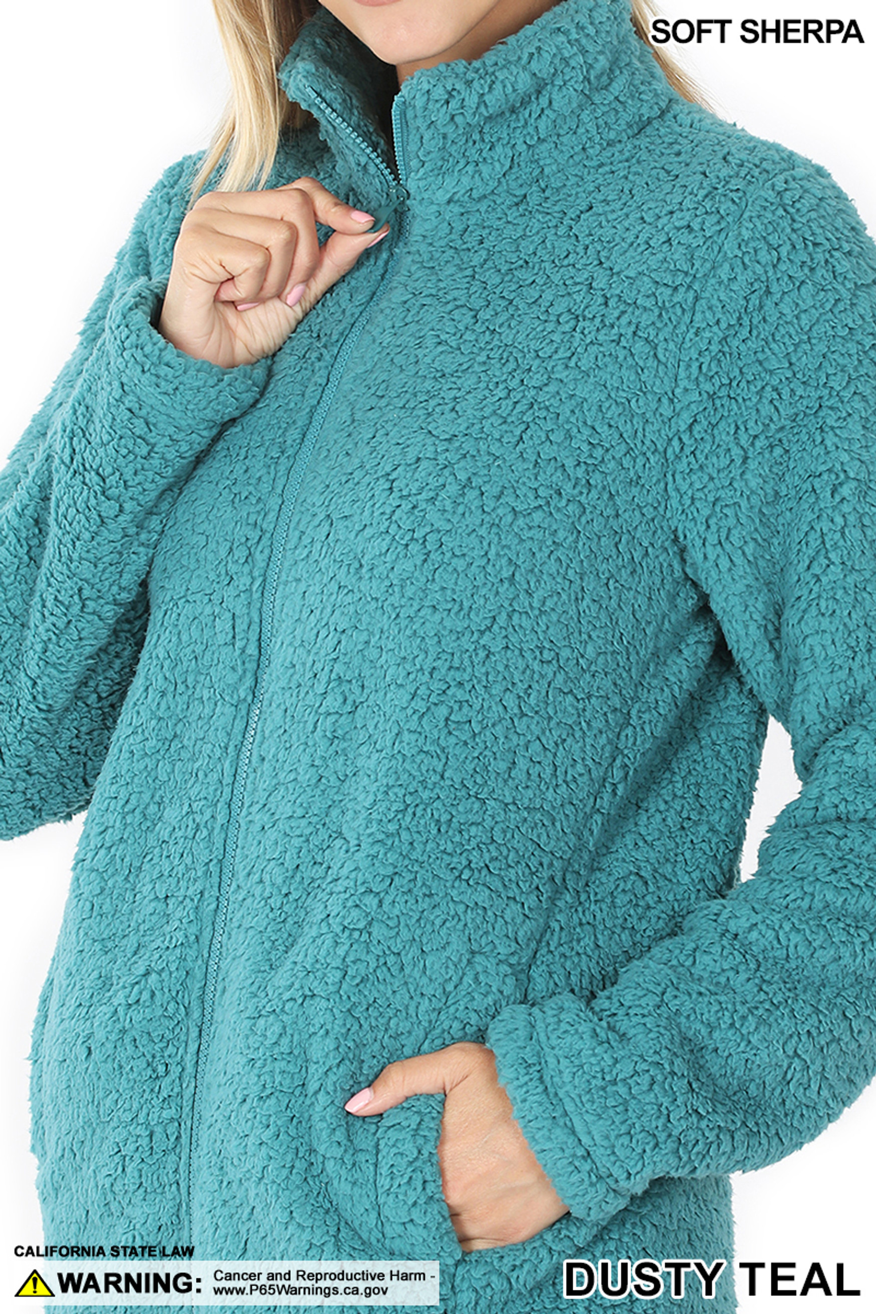 Close up of Dusty Teal Sherpa Zip Up Jacket with Side Pockets