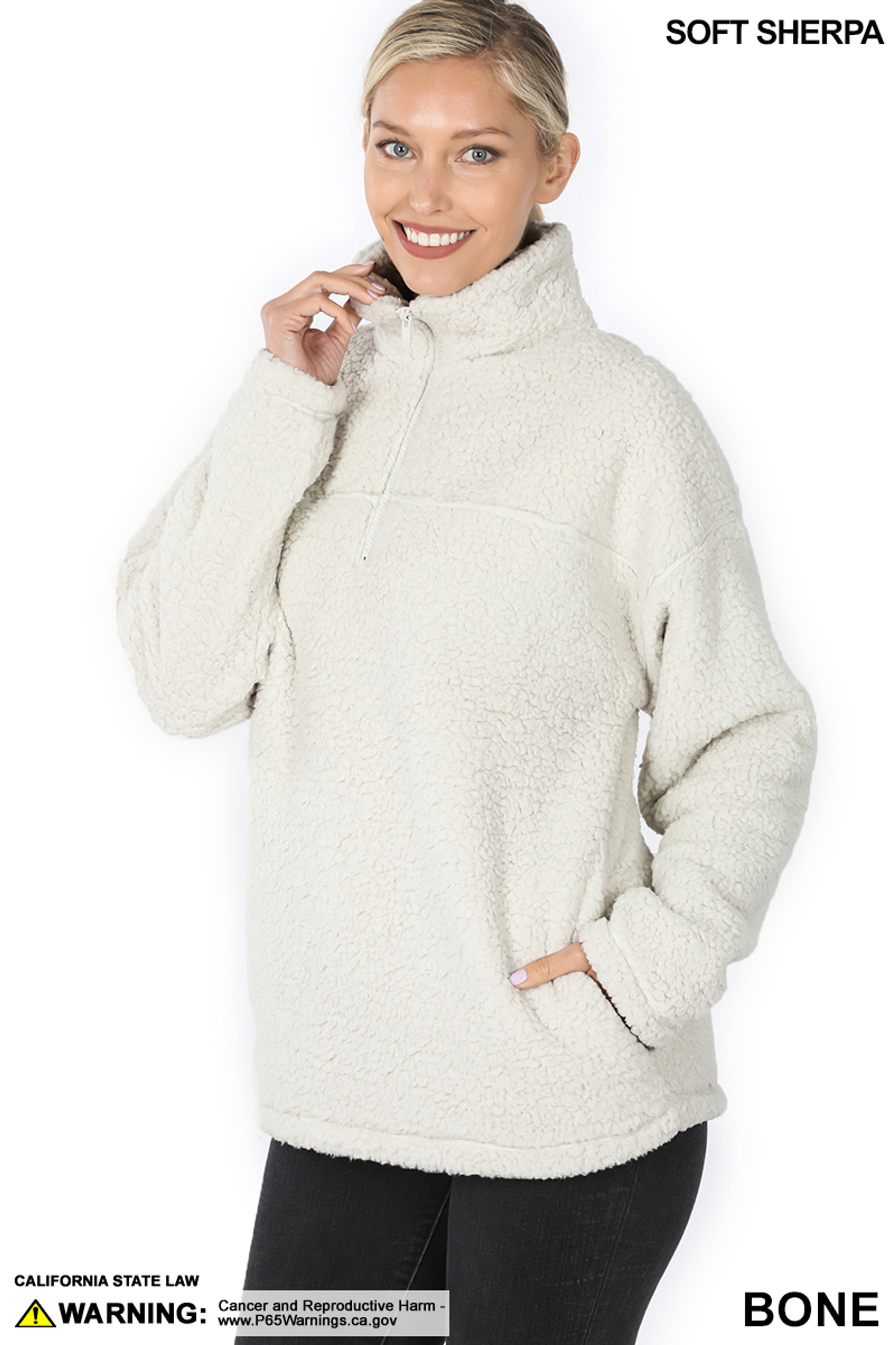 Slightly turned image of Bone Sherpa Half Zip Pullover with Side Pockets