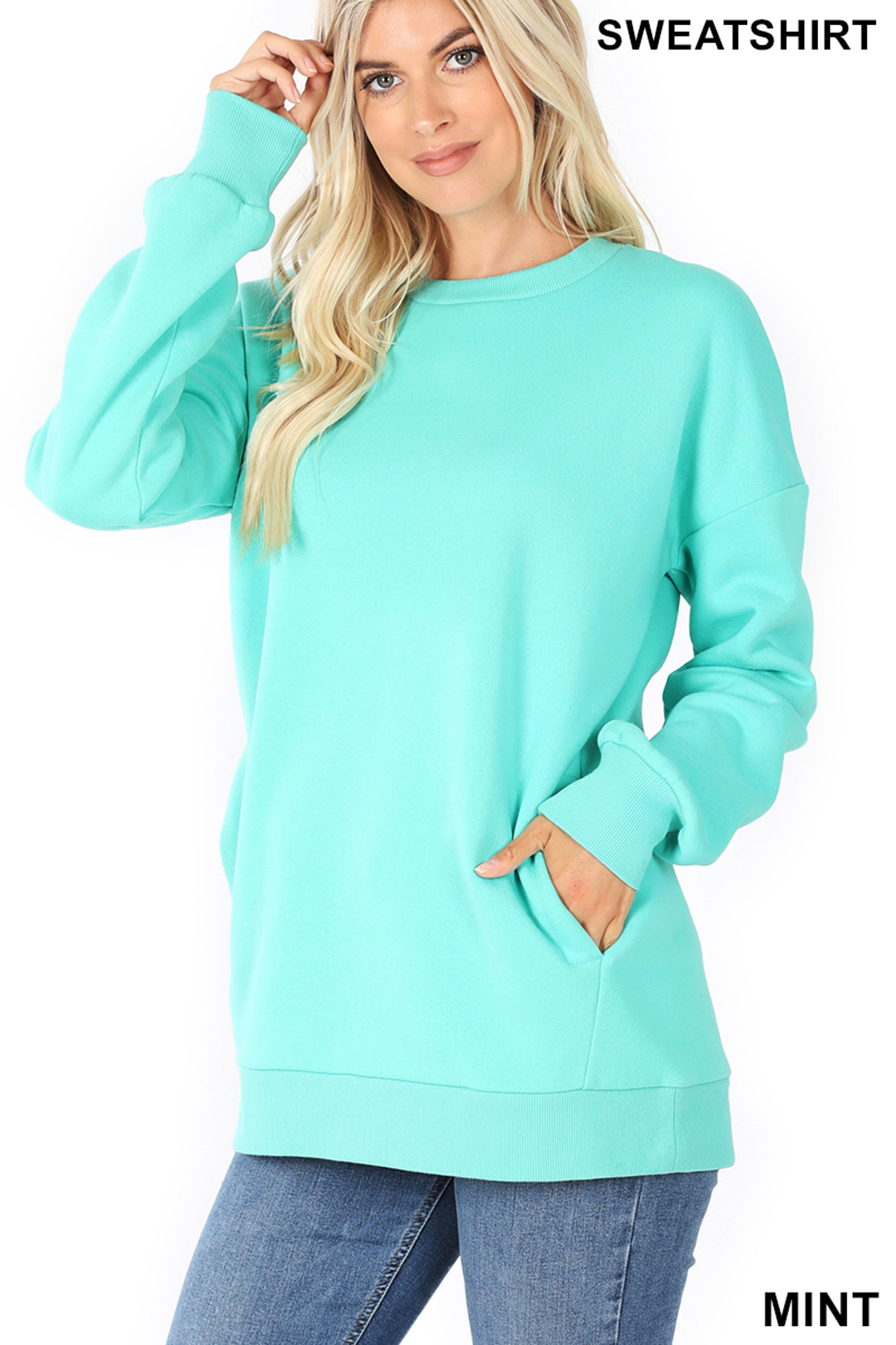 Slightly turned image of Mint Round Crew Neck Sweatshirt with Side Pockets