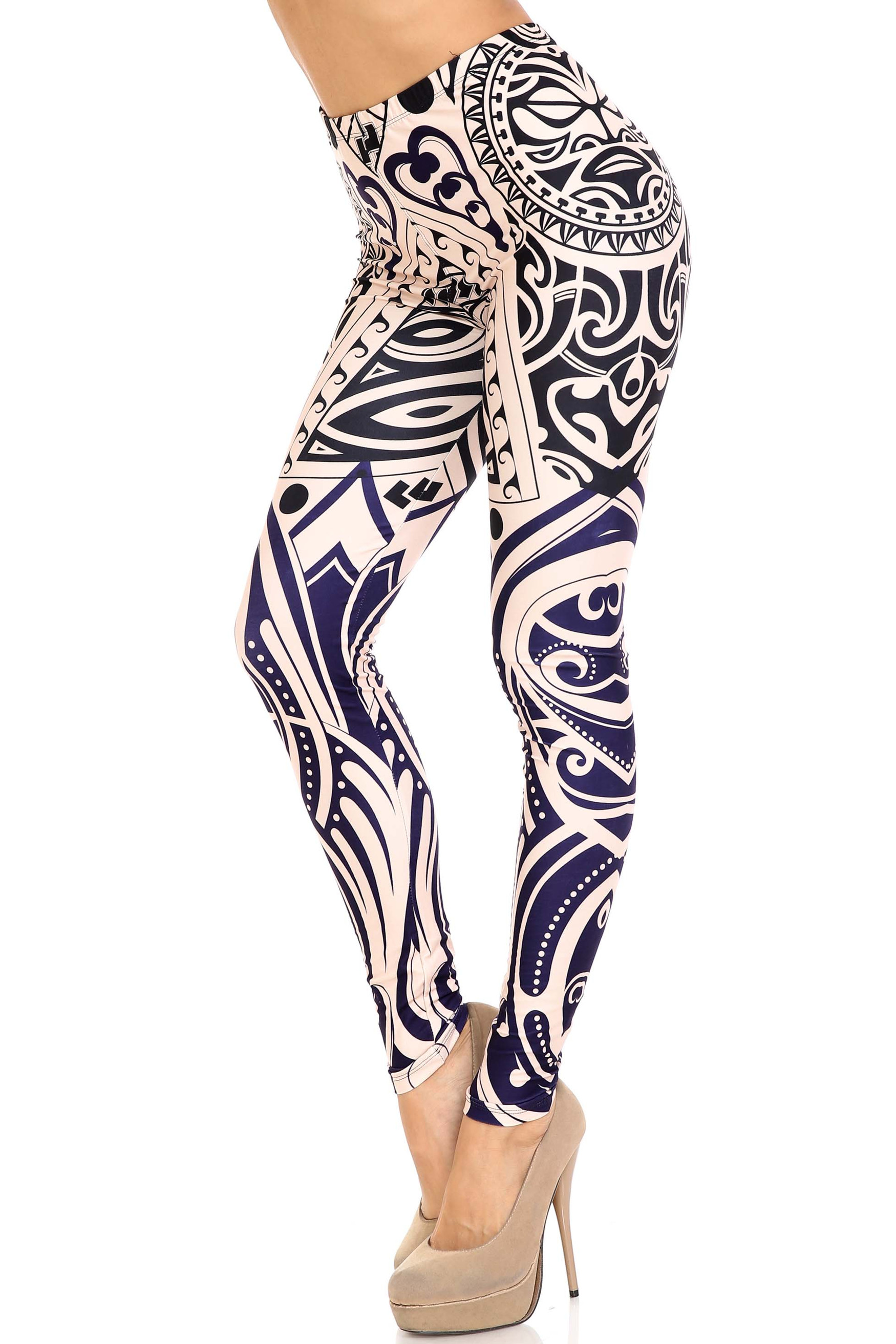 Left side right knee bent view of Creamy Soft Valhalla Extra Plus Size Leggings - 3X-5X - USA Fashion™ with an amazing bold navy and black on white design inspired by ancient art.