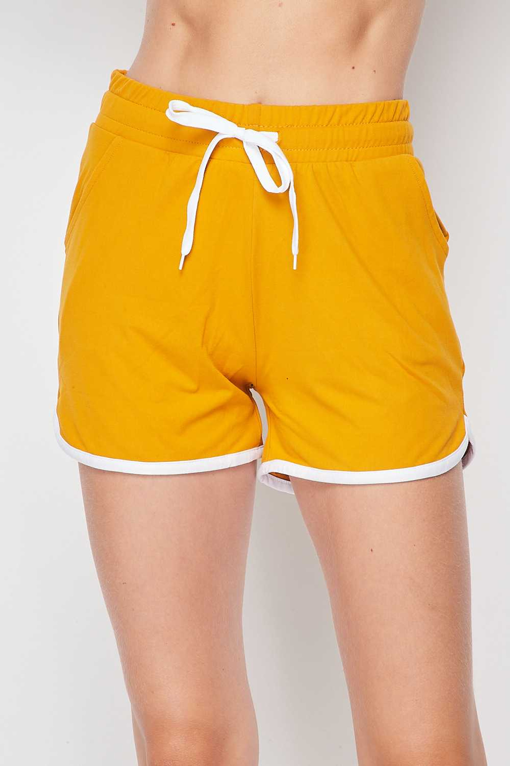 Front side view of Mustard Buttery Soft Drawstring Waist Plus Size Dolphin Shorts with Pockets