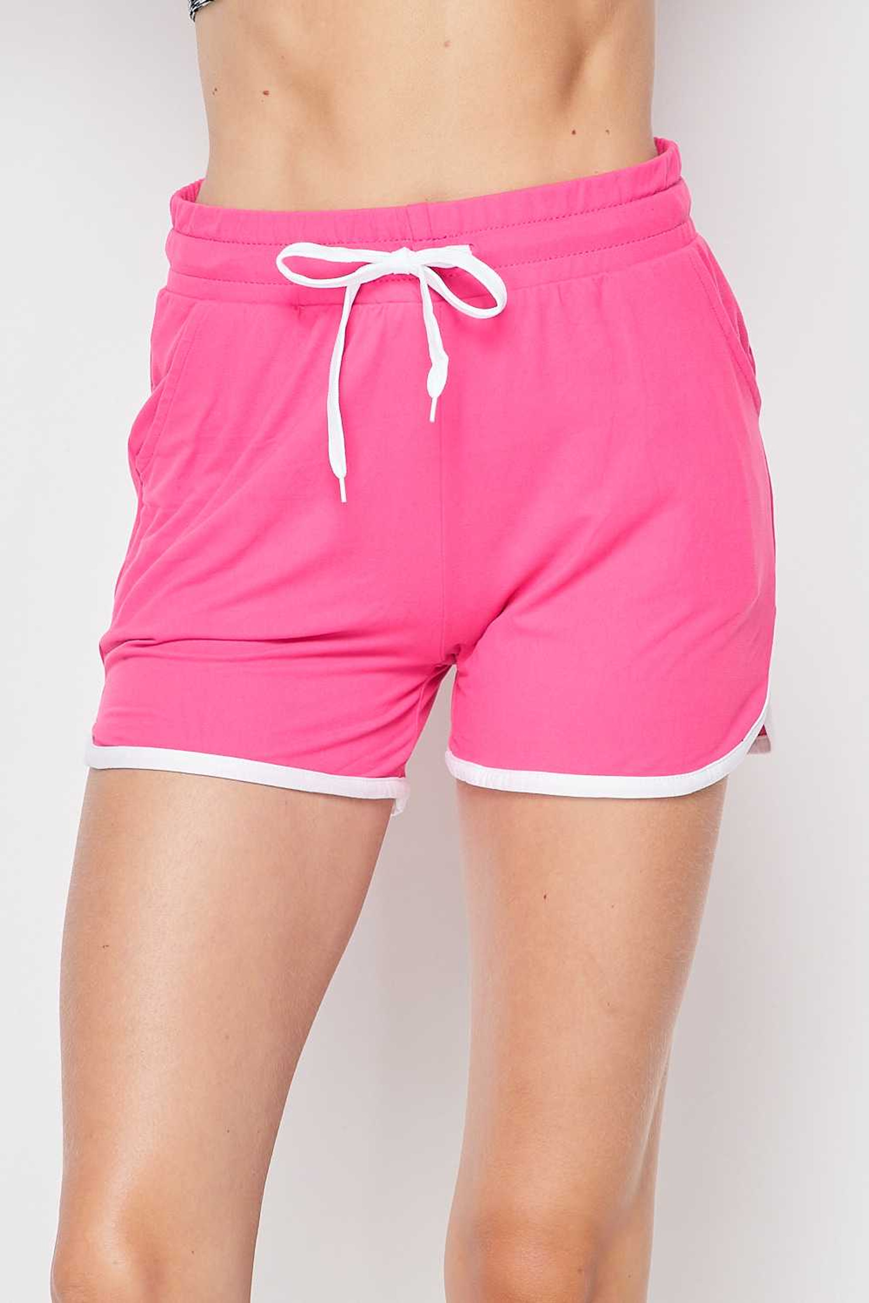 Front side view of Fuchsia Buttery Soft Drawstring Waist Plus Size Dolphin Shorts with Pockets