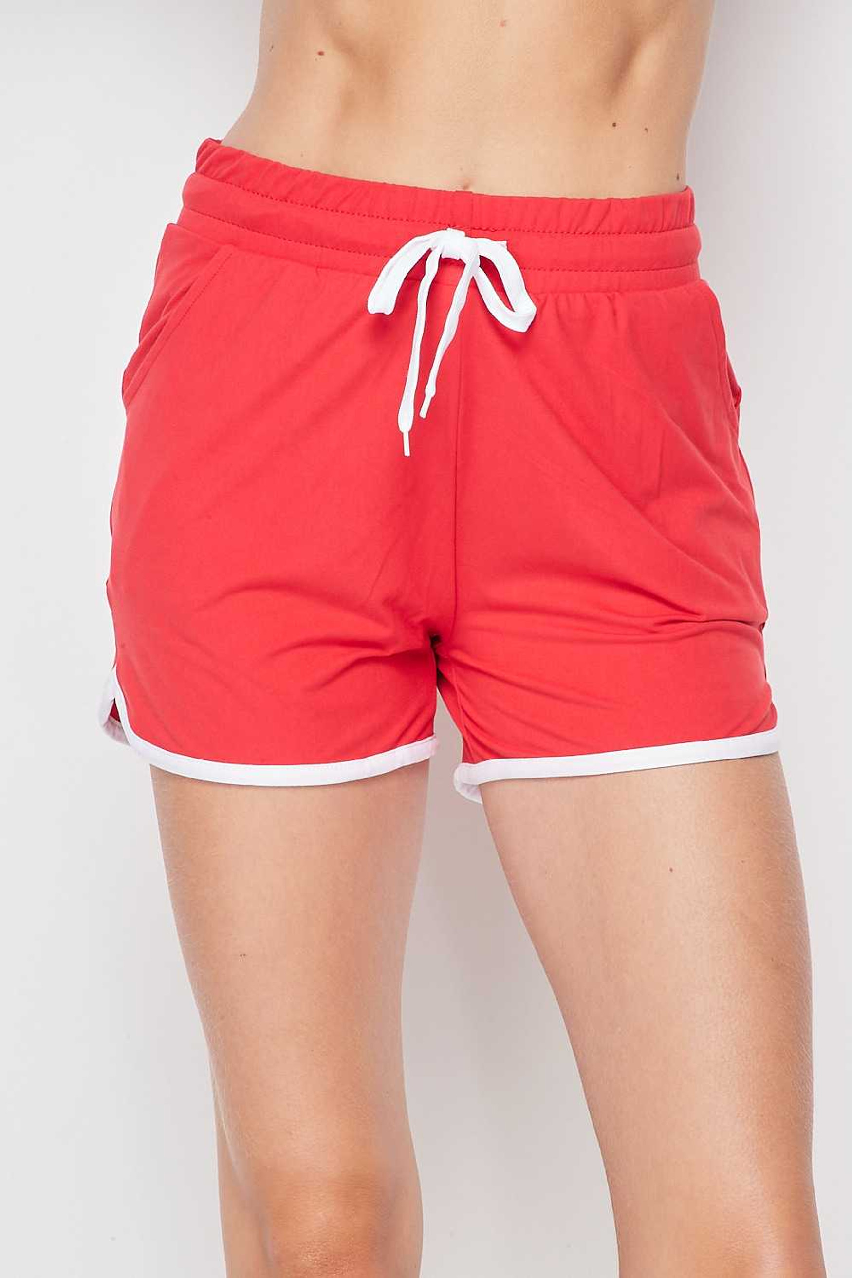 Front side view of Red Buttery Soft Drawstring Waist Plus Size Dolphin Shorts with Pockets