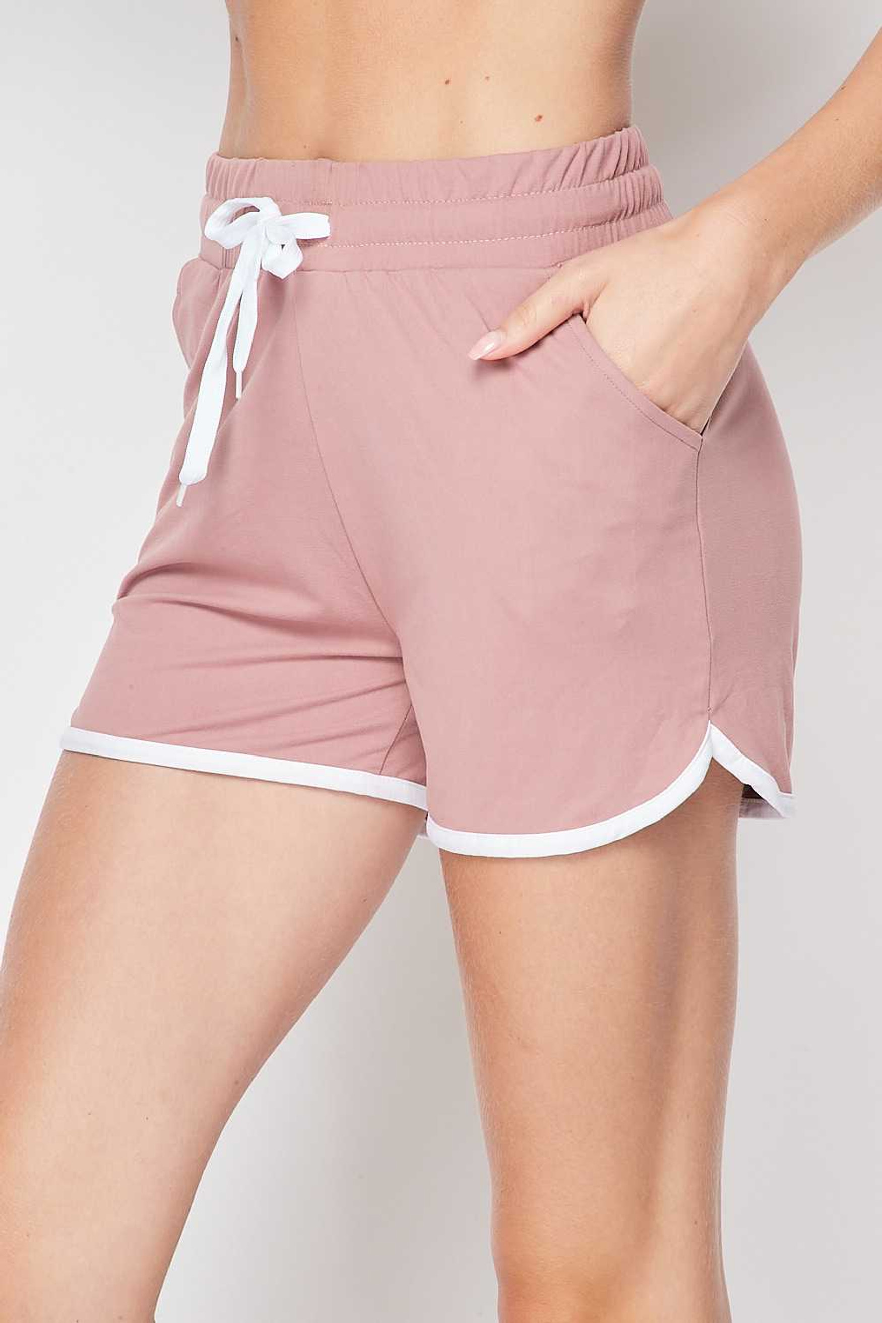 Left side of Mauve Buttery Soft Drawstring Waist Plus Size Dolphin Shorts with Pockets