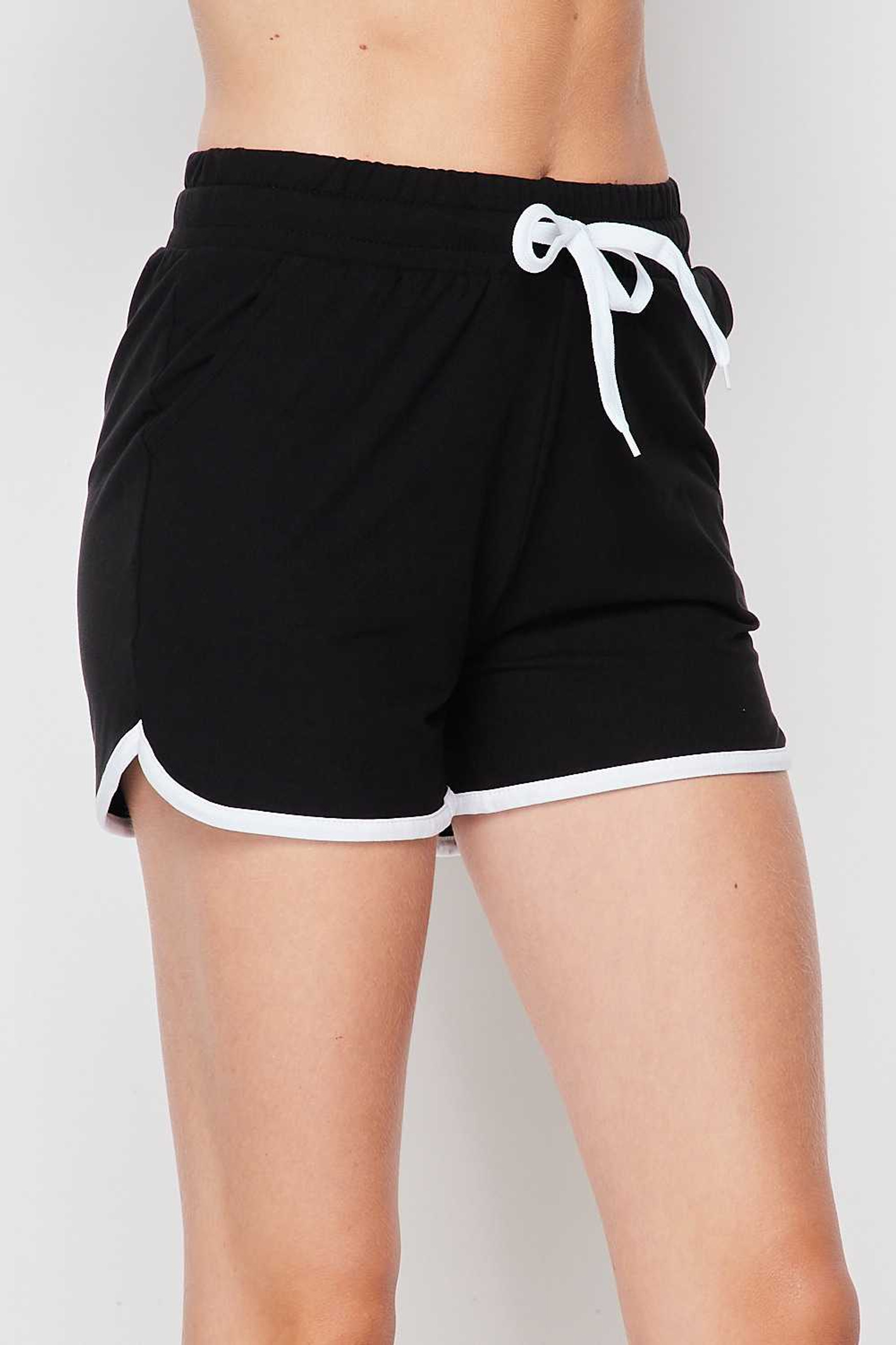 Right side of Black Buttery Soft Drawstring Waist Dolphin Shorts with Pockets