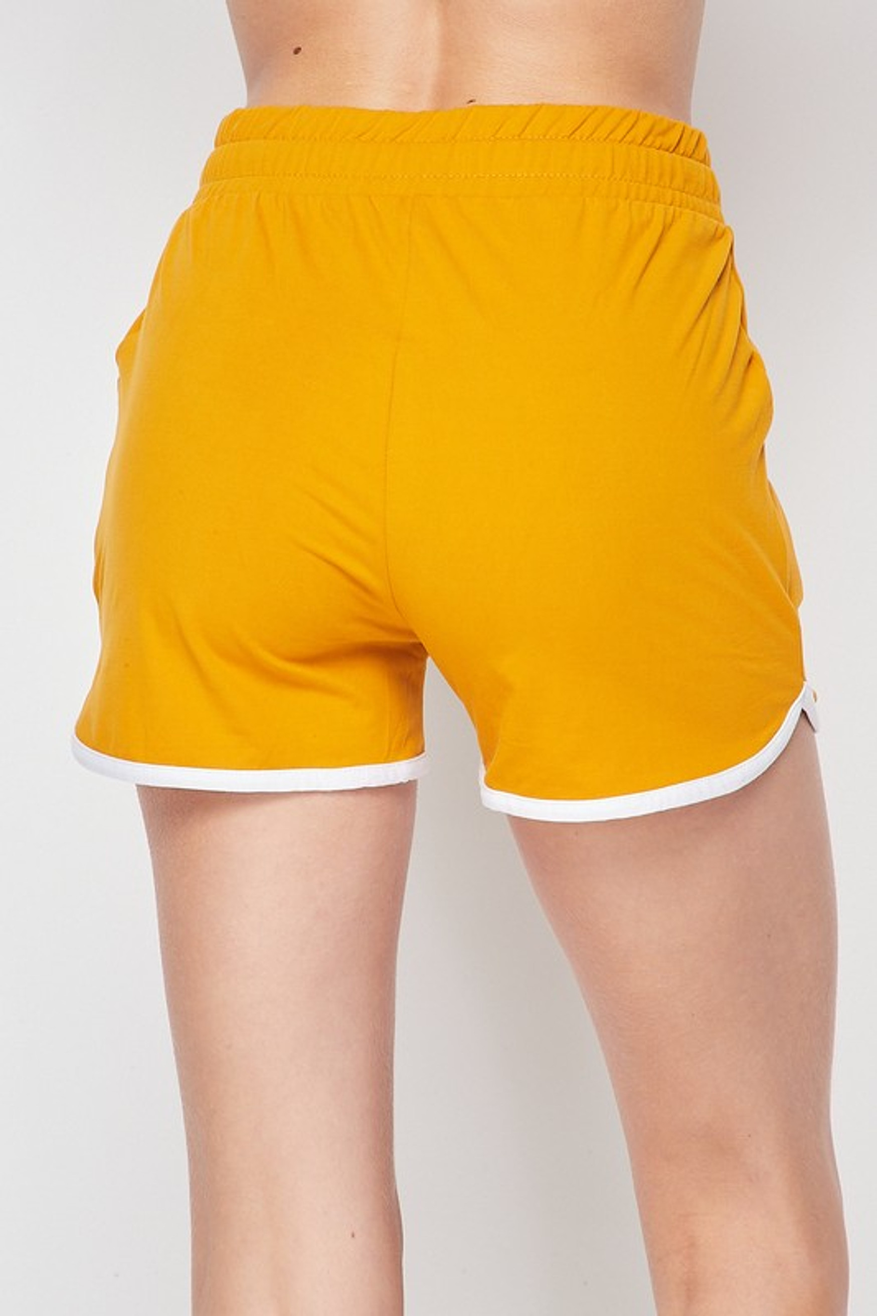 Back side of Mustard Buttery Soft Drawstring Waist Dolphin Shorts with Pockets