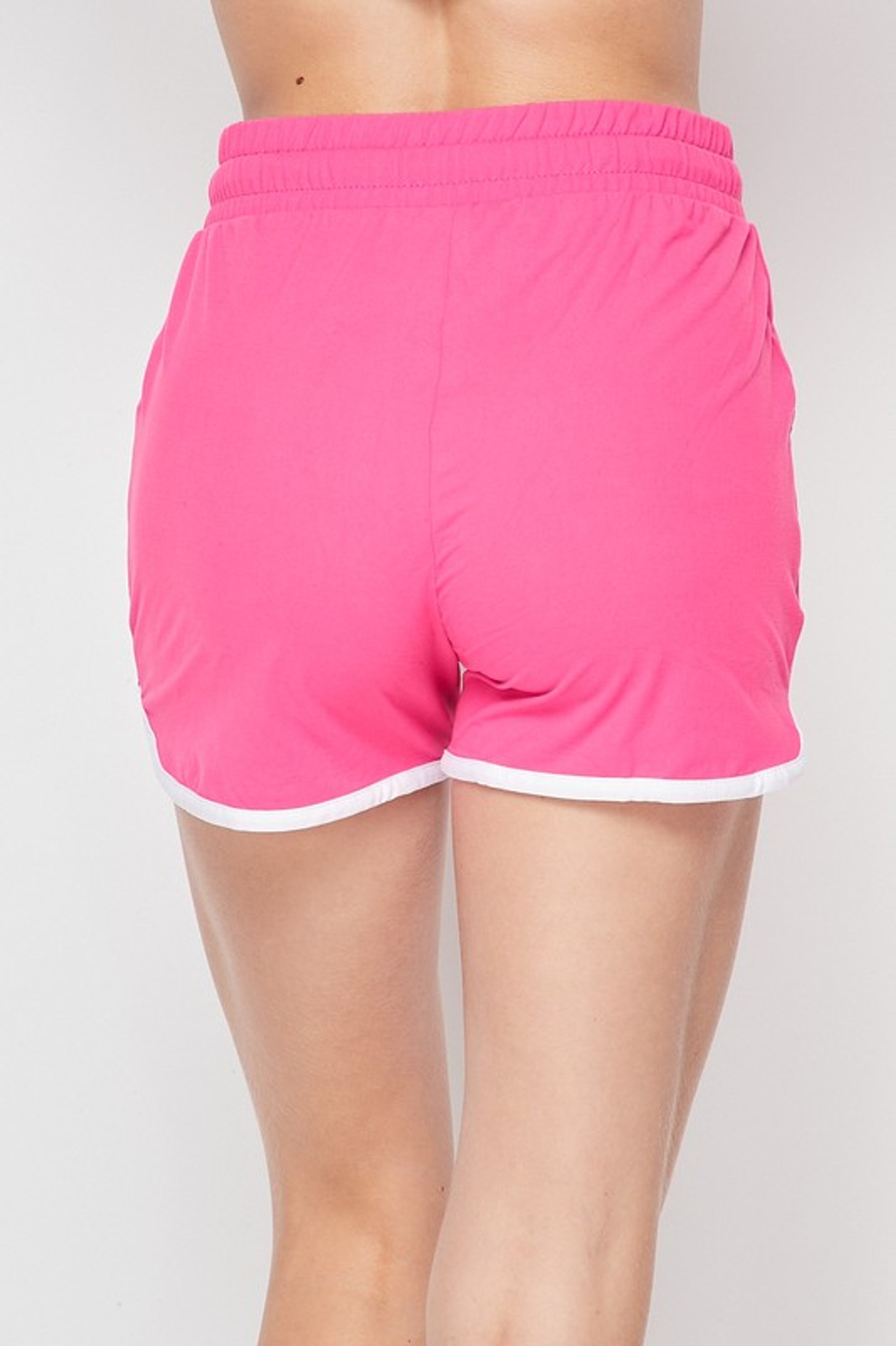 Back side of Fuchsia Buttery Soft Drawstring Waist Dolphin Shorts with Pockets