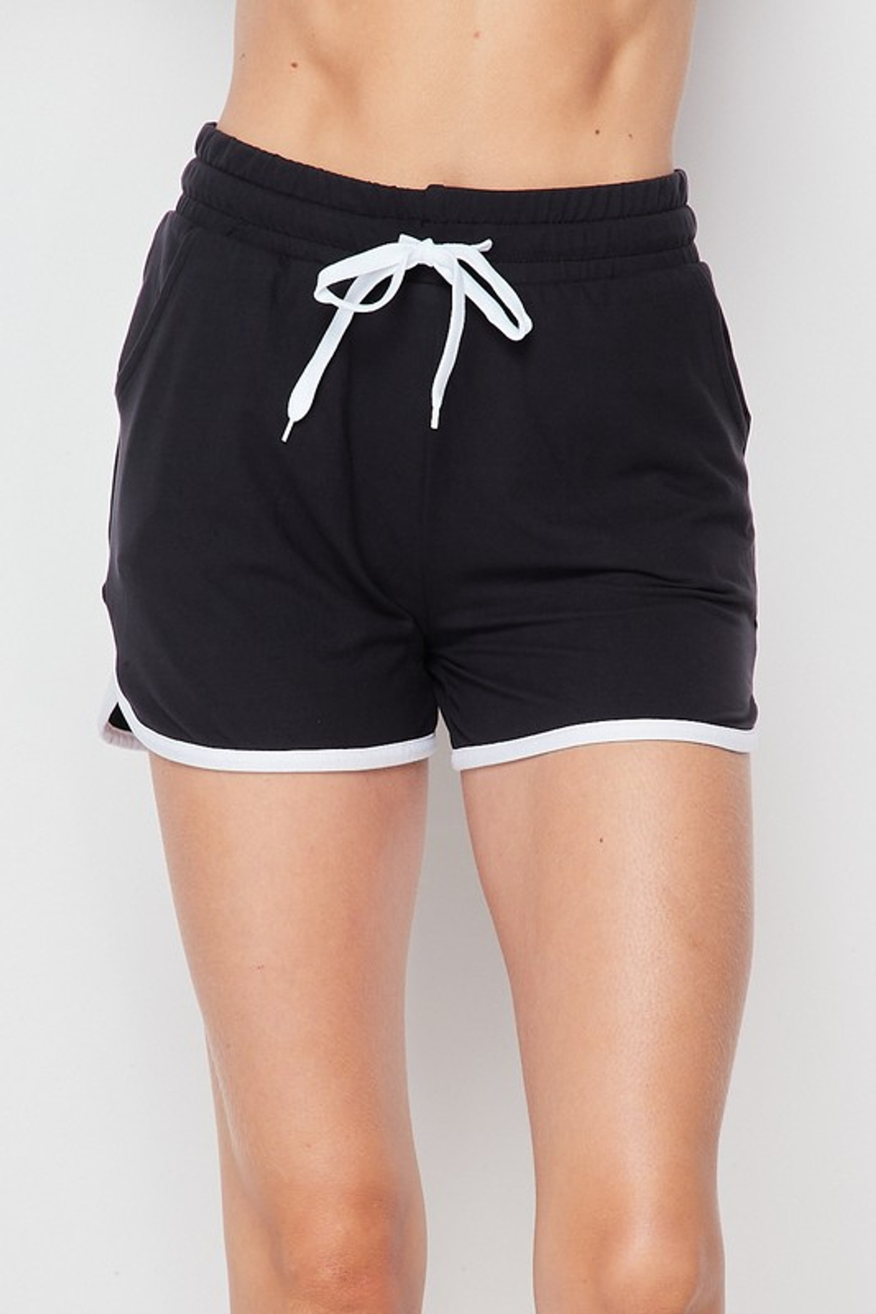 Front side of Black Buttery Soft Drawstring Waist Dolphin Shorts with Pockets