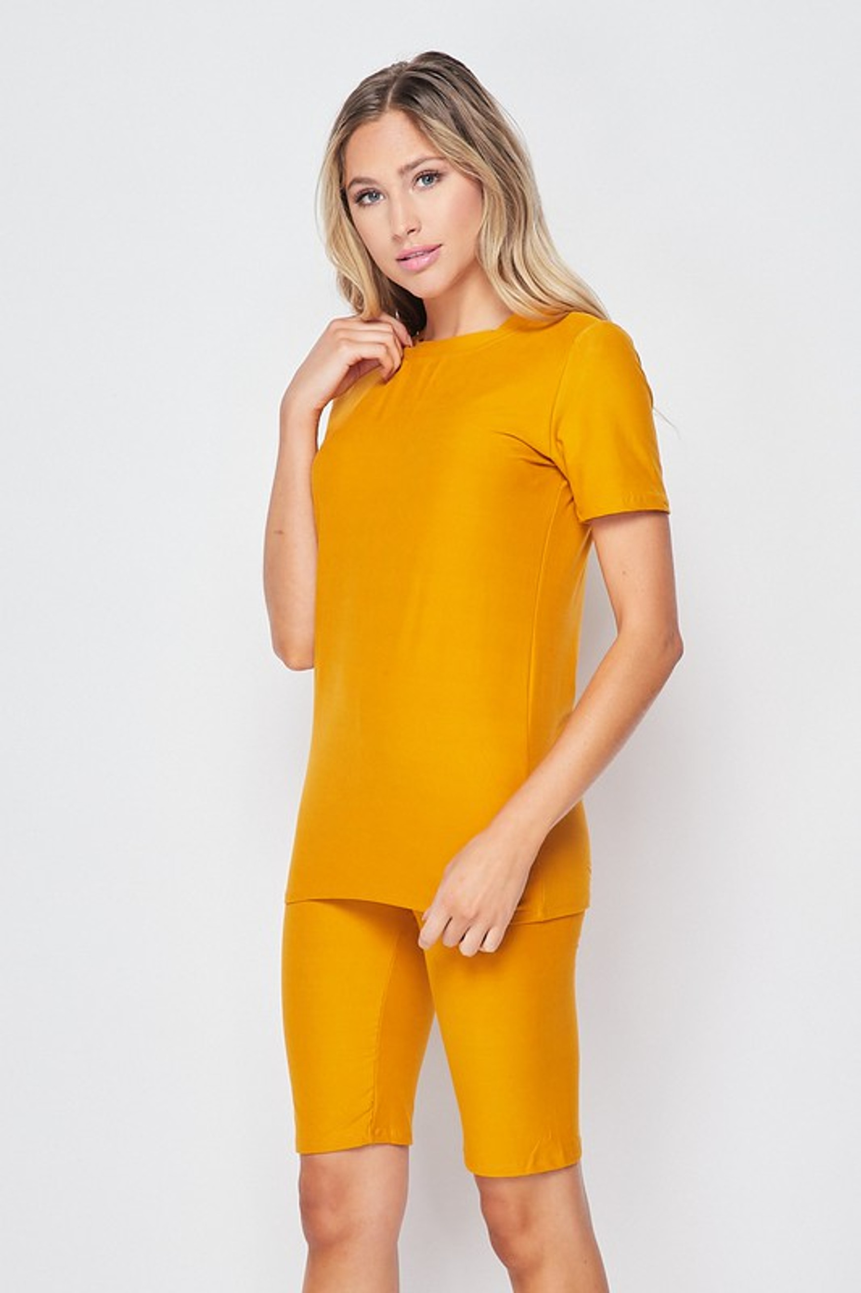 45 degree view of Mustard Buttery Soft Basic Solid Biker Shorts and T-Shirt Set