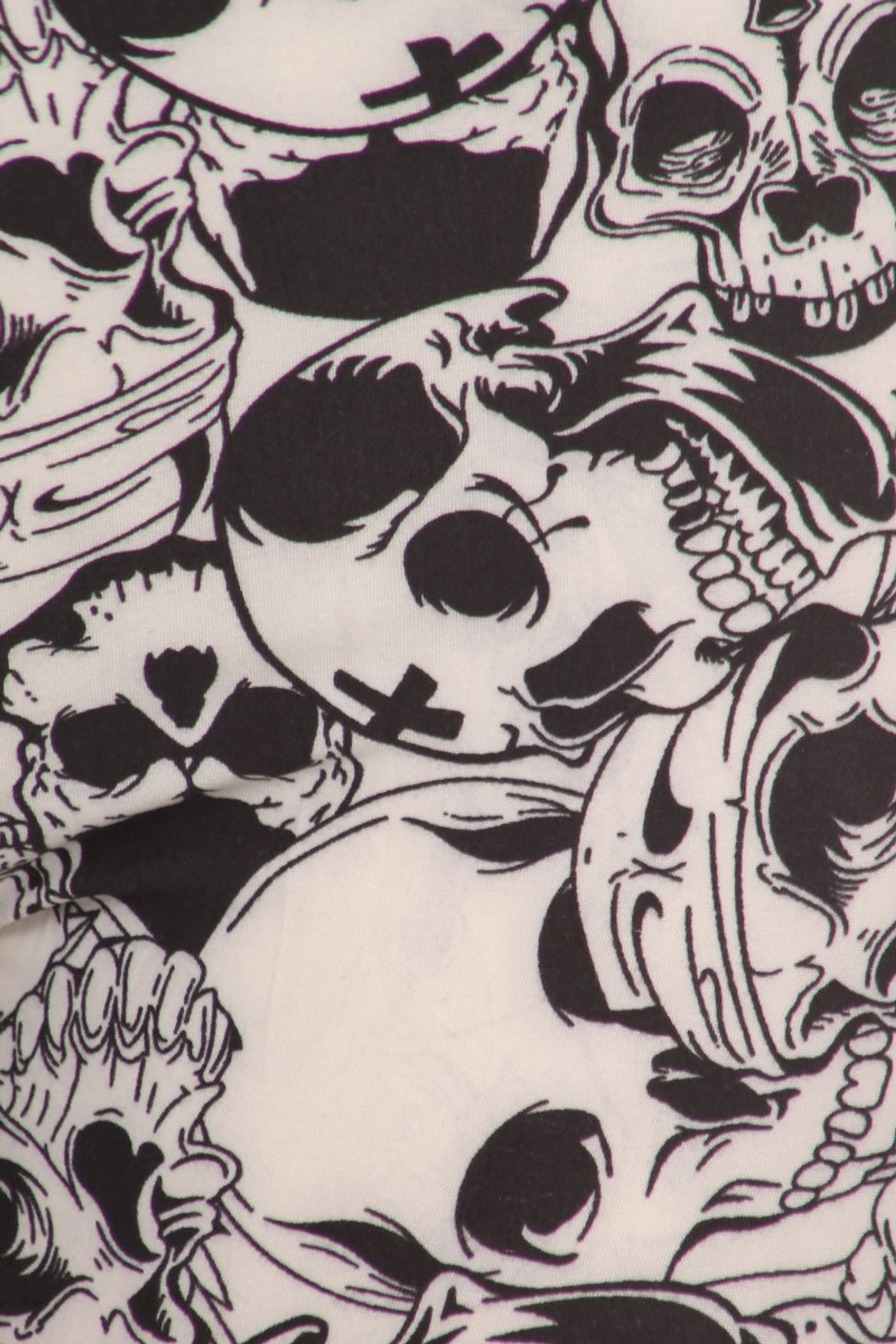 Close-up fabric image of  Buttery Soft White Layers of Skulls Leggings
