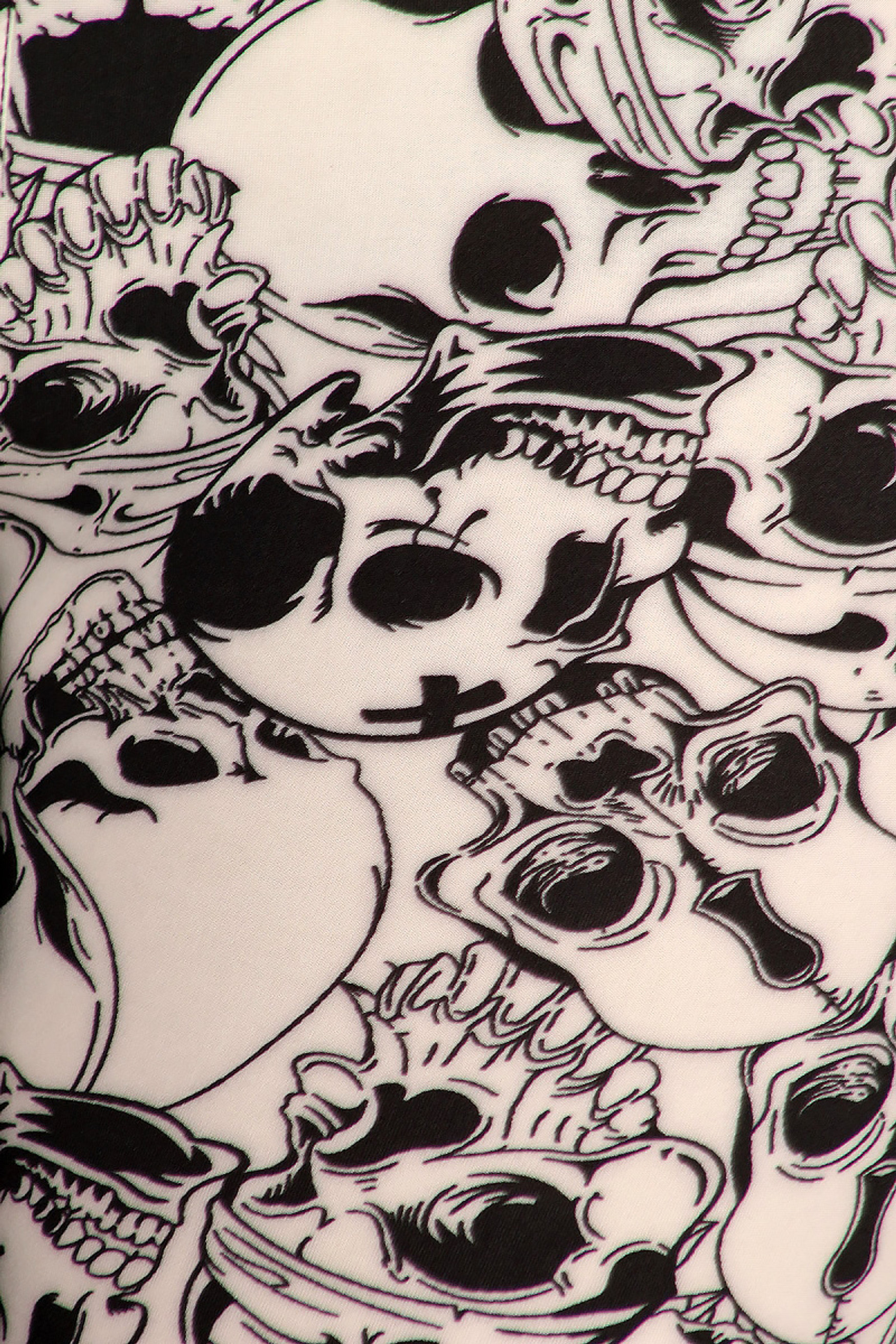 Close-up fabric image of  Buttery Soft White Layers of Skulls Plus Size Leggings - 3X-5X