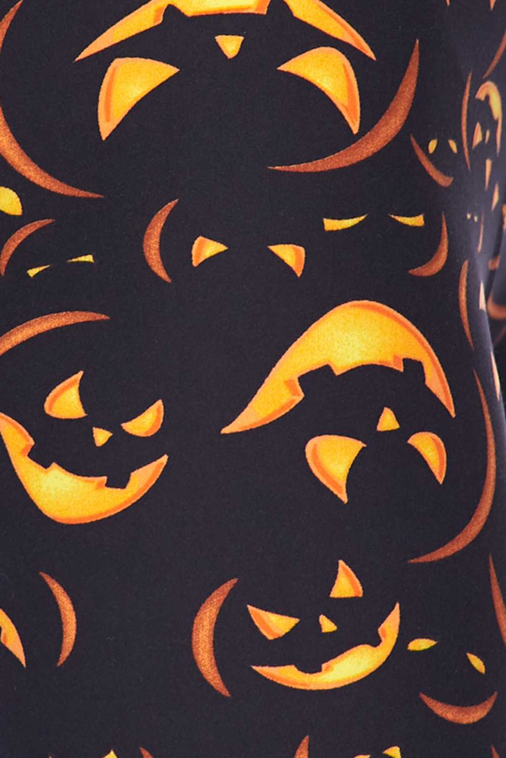 Close up fabric swatch of Buttery Soft Evil Halloween Pumpkins Plus Size Leggings