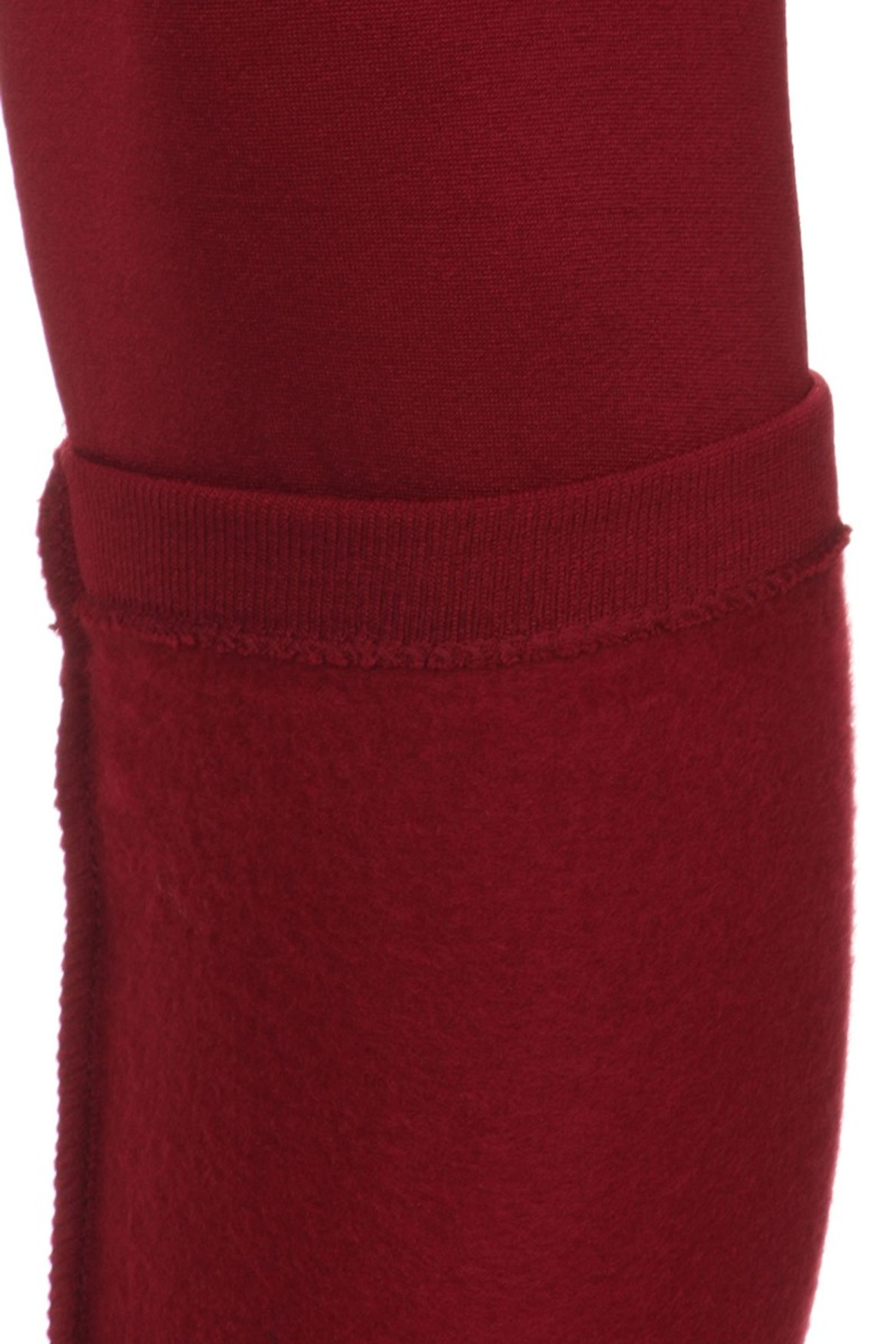 close-up image of a Burgundy Banded High Waisted Fleece Lined Legging of the calf showing the legging inside detailing the inner fleece lining and trim stitching.
