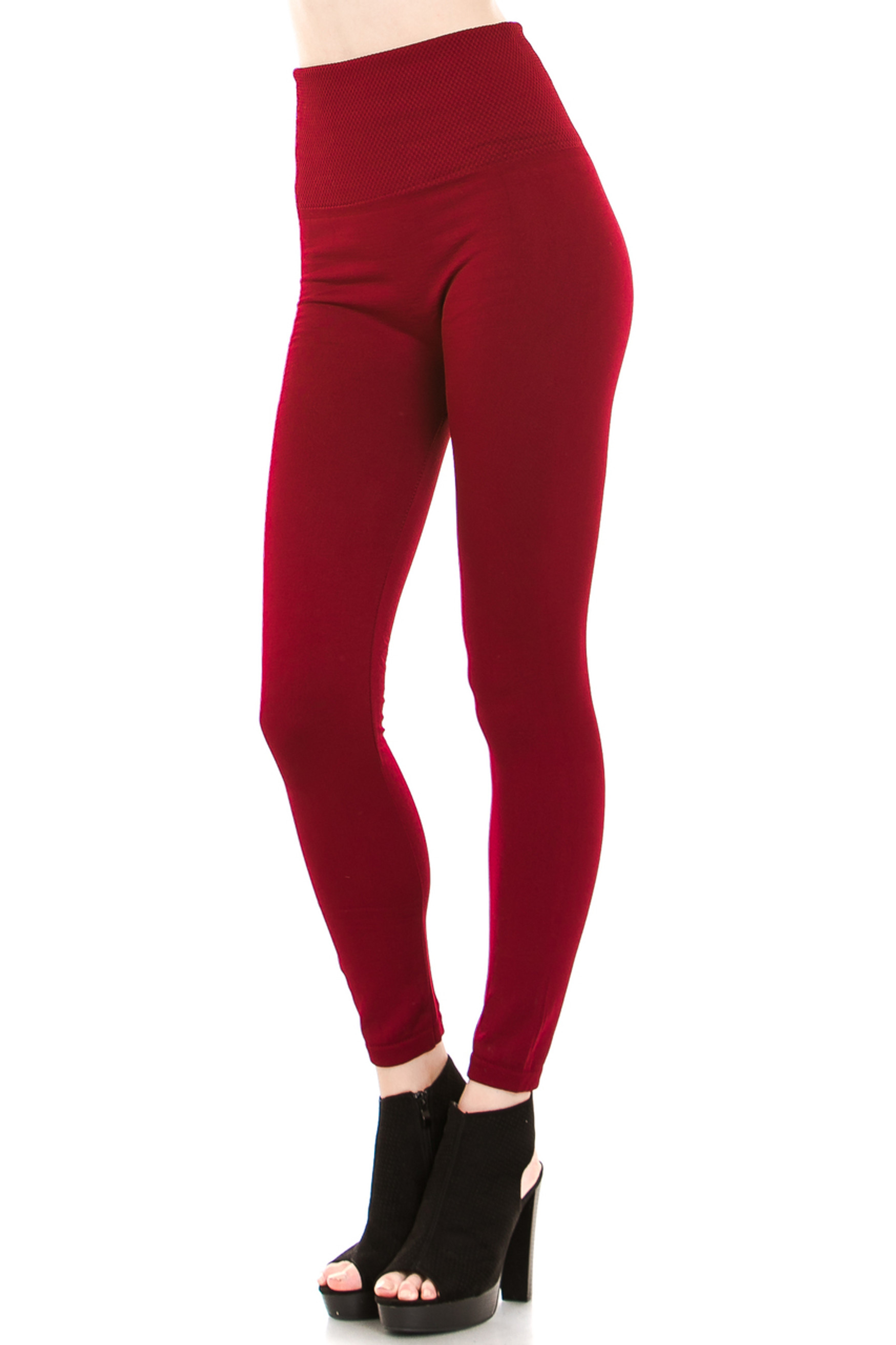 45 degree image of our Burgundy Banded High Waisted Fleece Lined Leggings showing the ribbed high waisted fabric waist band and full length Burgundy fleece legging