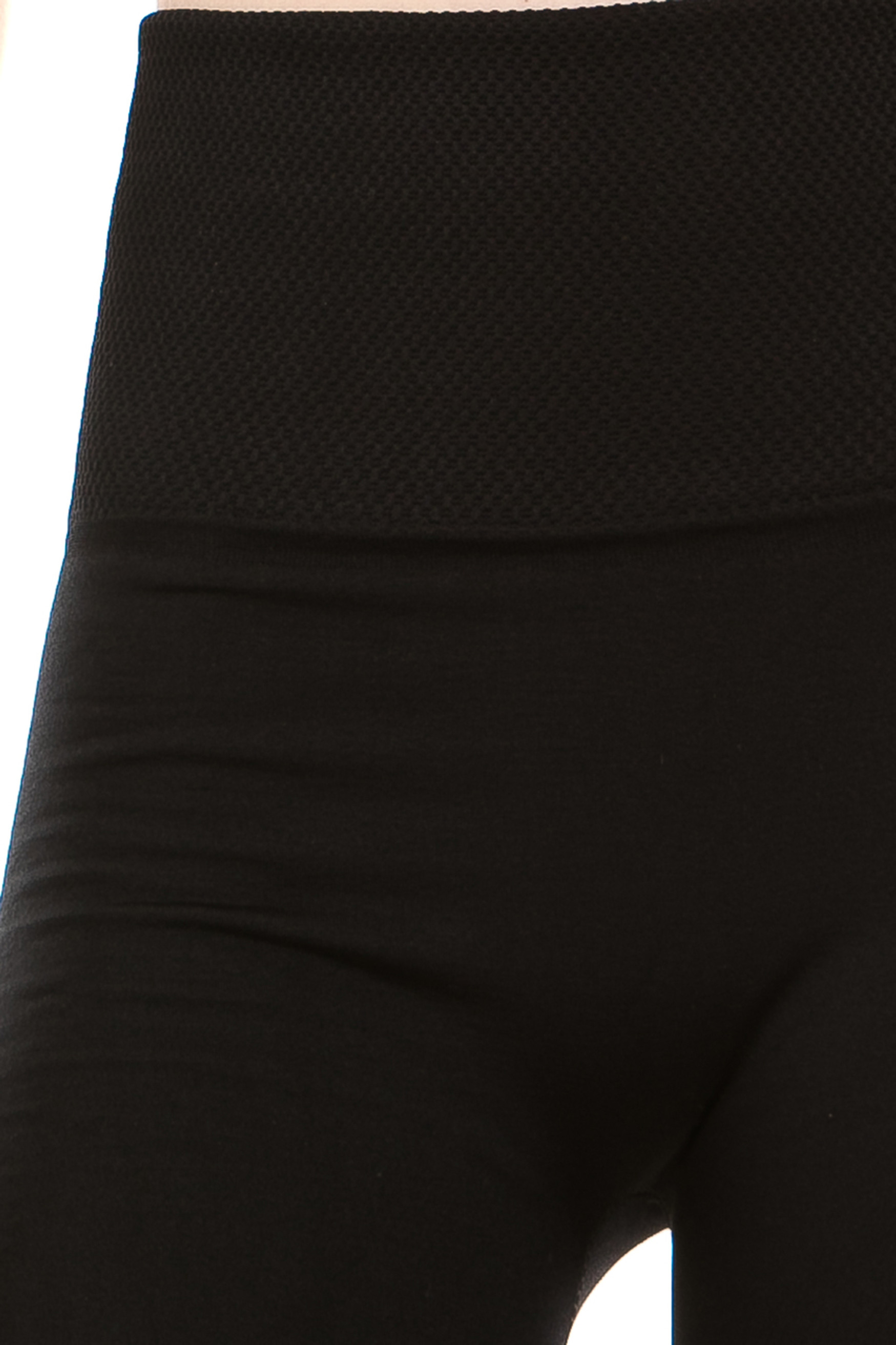 close-up image of the crotch area of our Black Banded High Waisted Fleece Lined Legging clearly showing the ribbed high waist fabric waist band and warm, tight fit and comfortable fleece fabric
